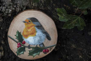 Robin on holly branch  painting on a willow wood slice